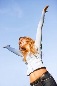bigstockphoto_Woman_Full_Of_Success_4026014